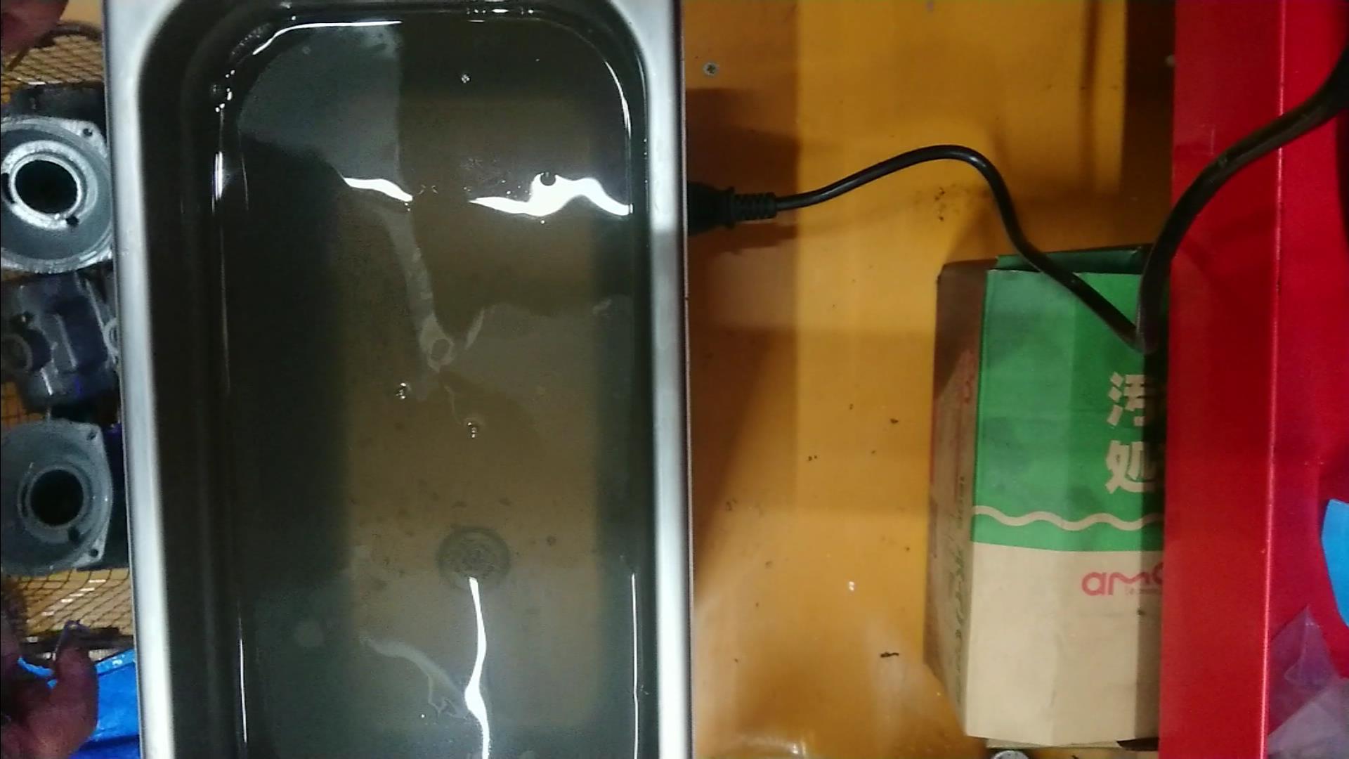 超音波洗浄後の水